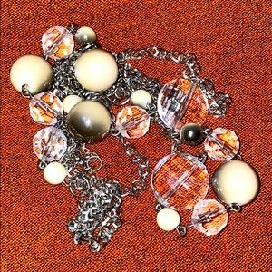 Triple strand silver and beaded necklace.